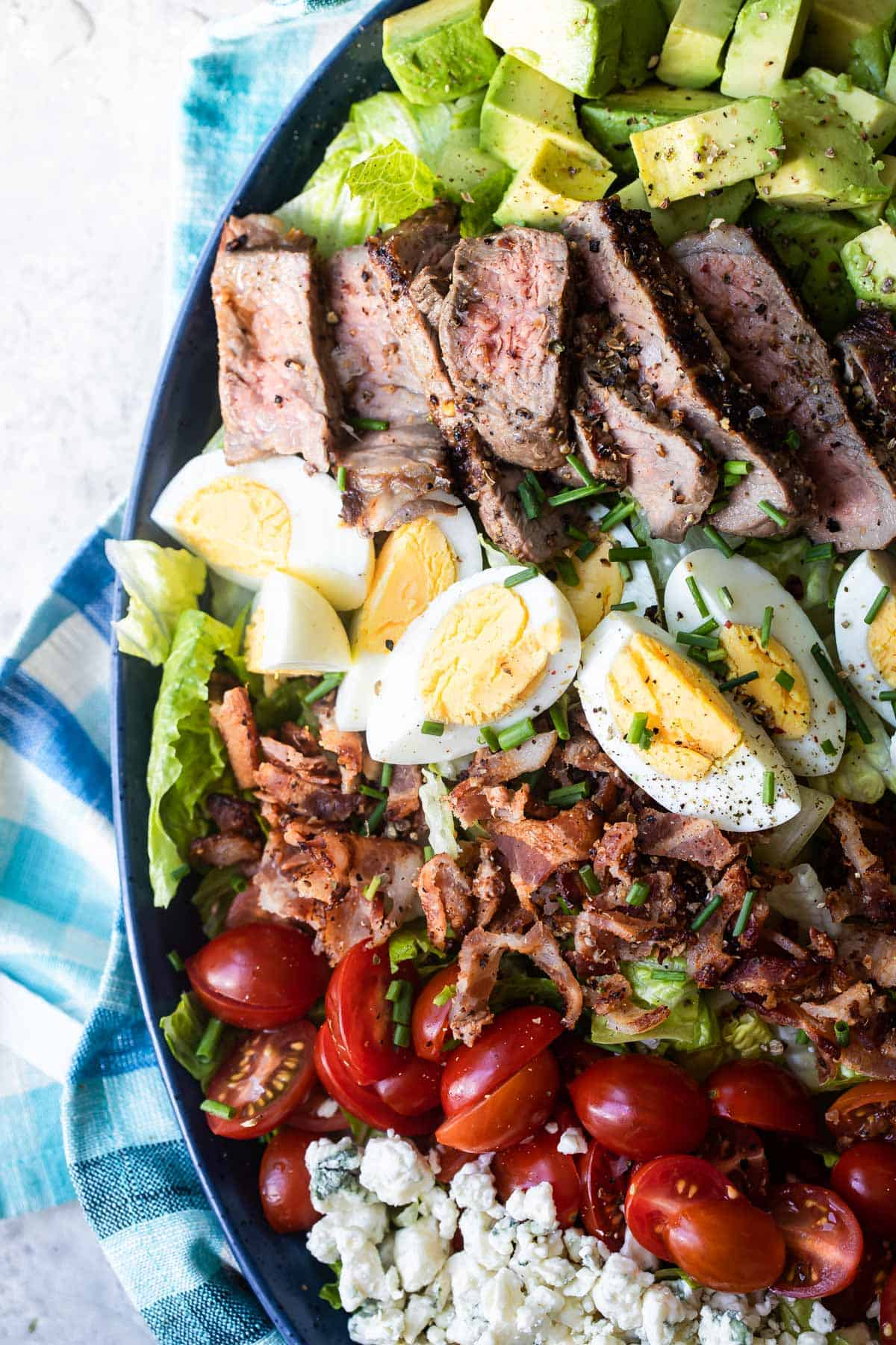 steak Cobb salad recipe on a large plate