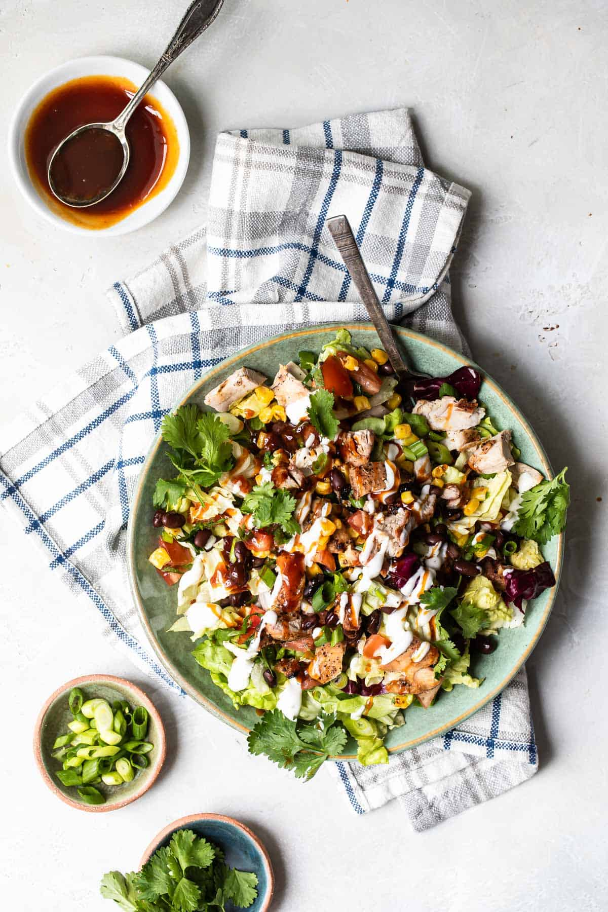bbq grilled chicken chopped salad with bbq sauce and cilantro on the side
