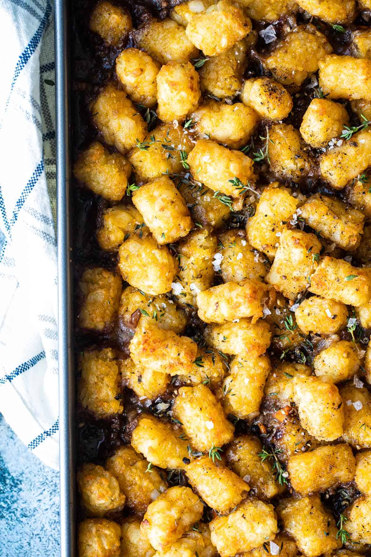 tater tot covered cottage pie in a pan