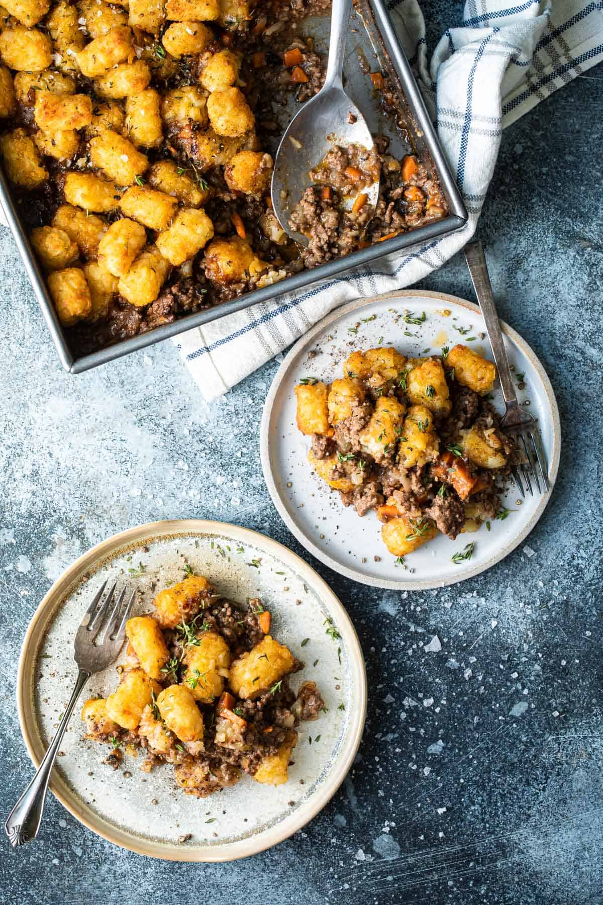 2 plates with scoops of cottage pie and crispy tater tots