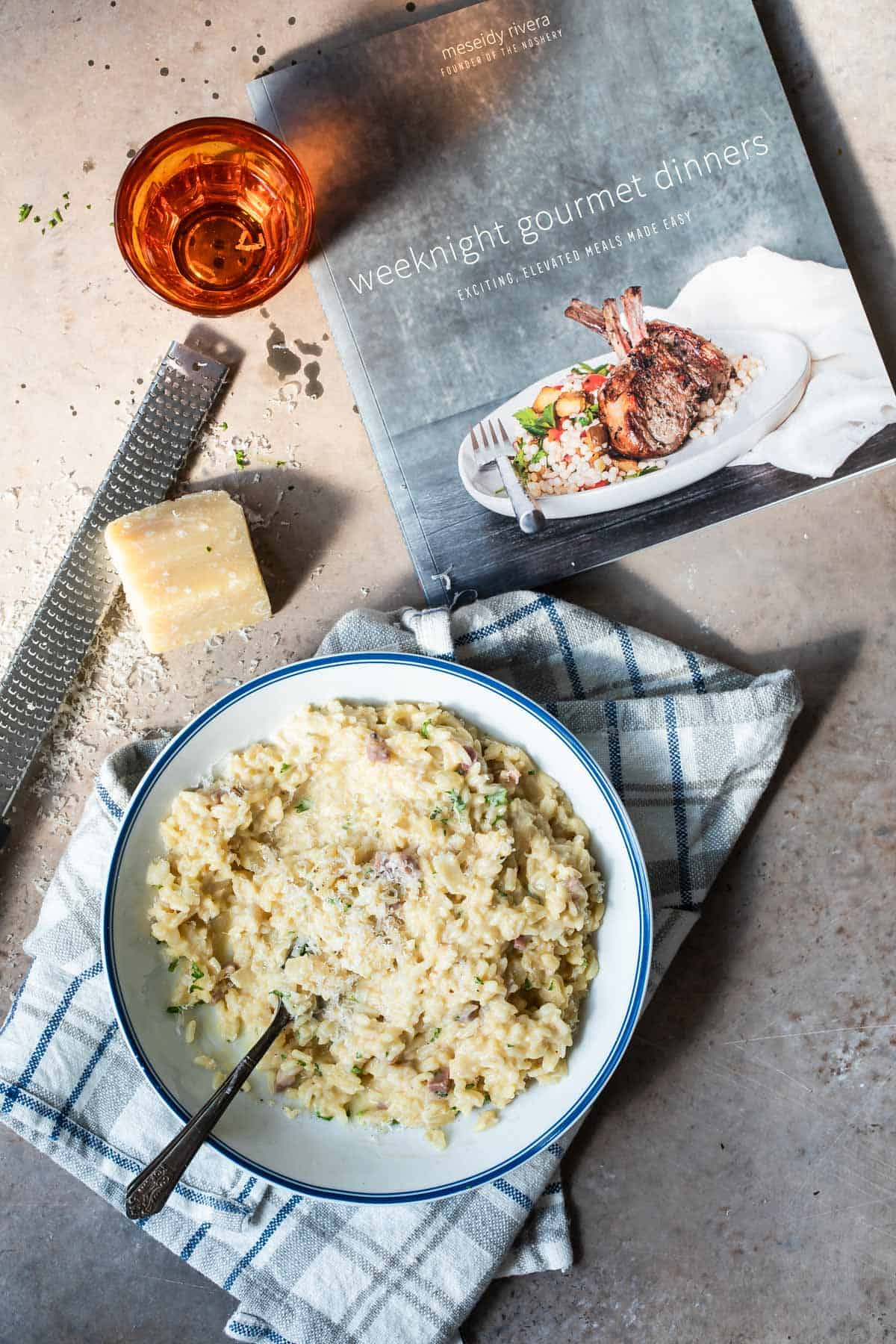 Instant pot risotto with a cook book on a board