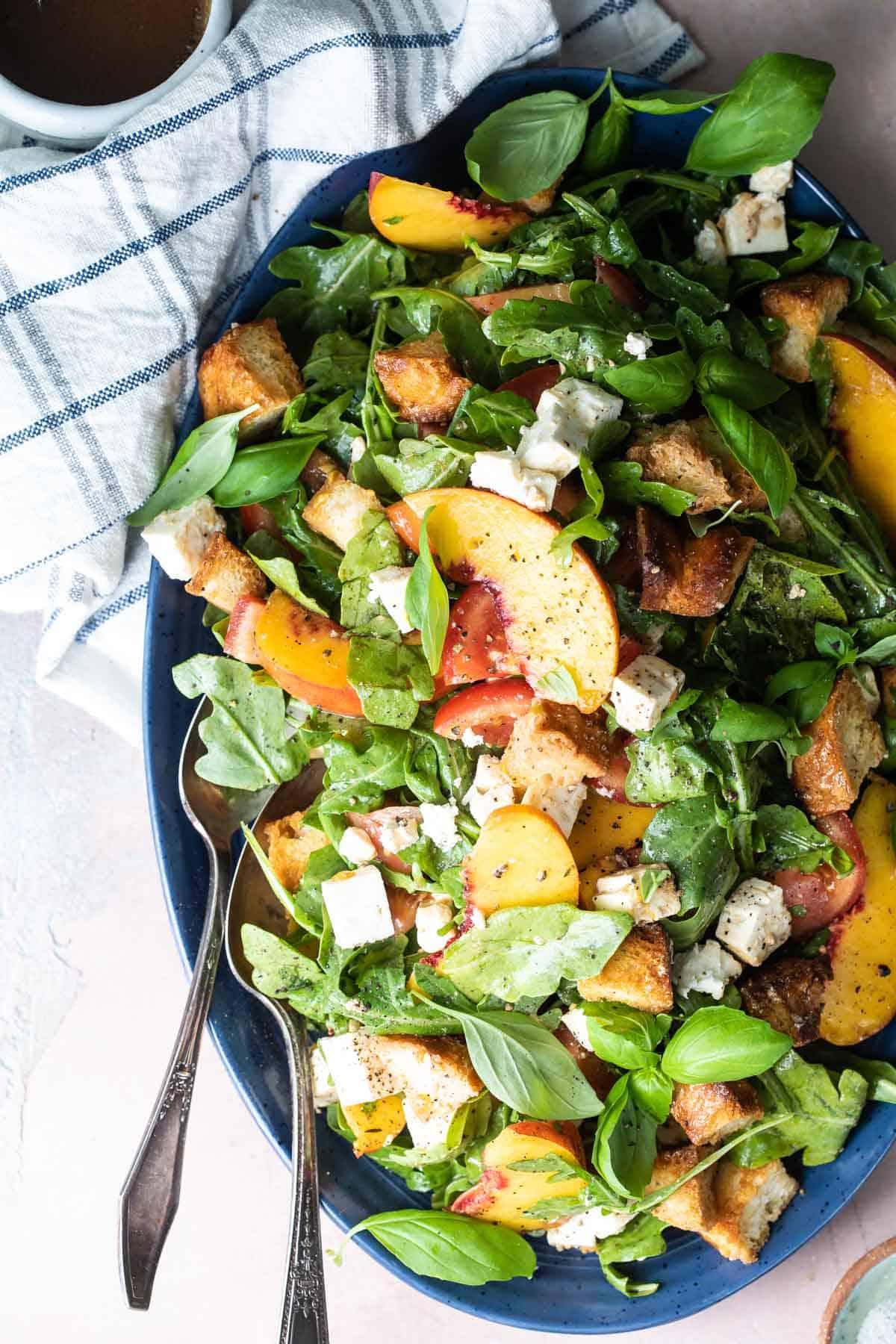 peach and feta panzanella salad with arugula