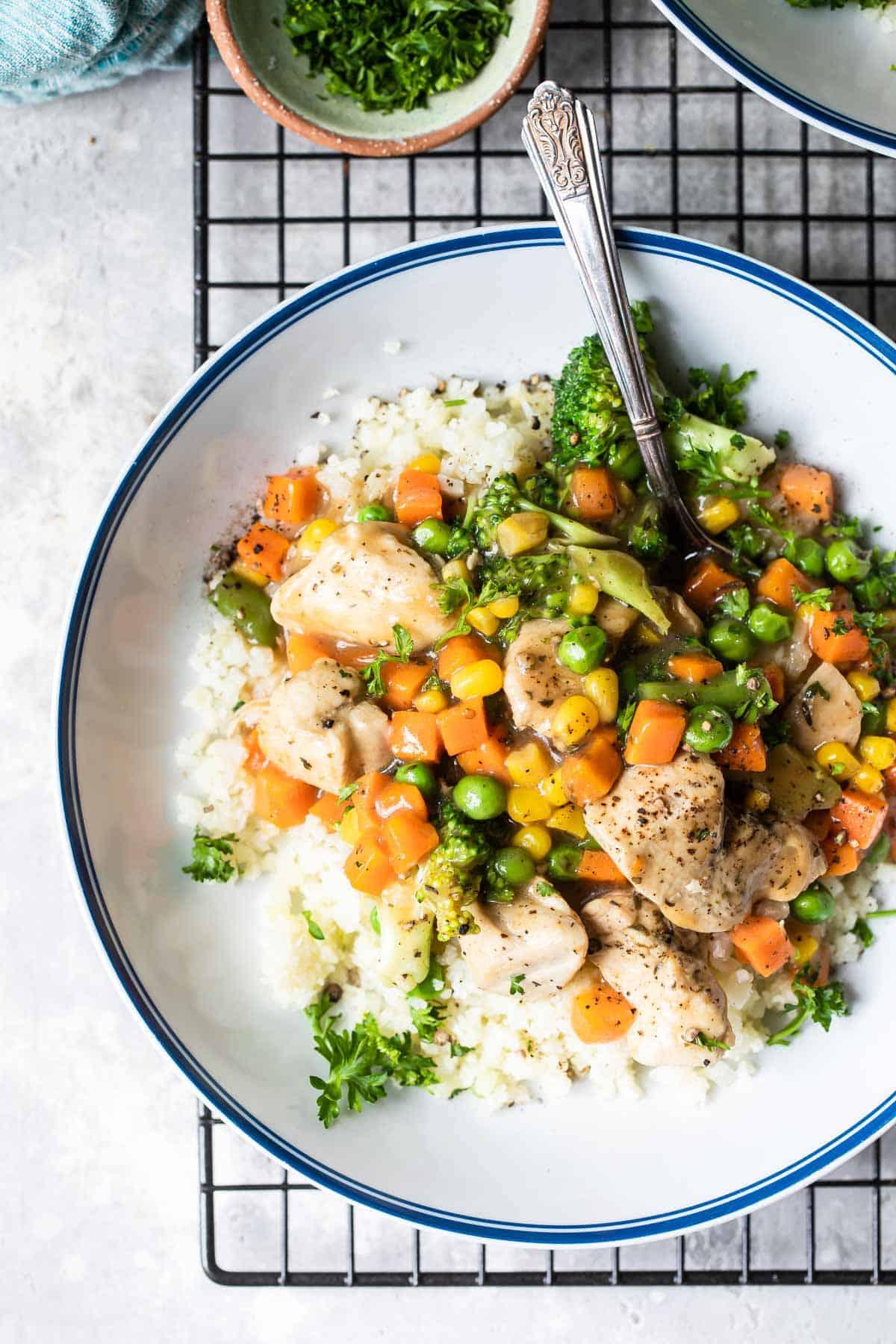 chicken pot pie in a bowl with cauliflower rice