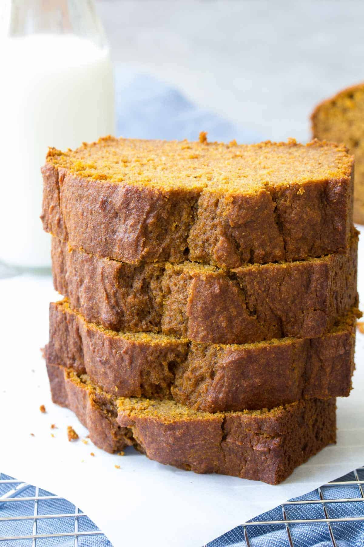 pumpkin bread slices stacked on top of one another