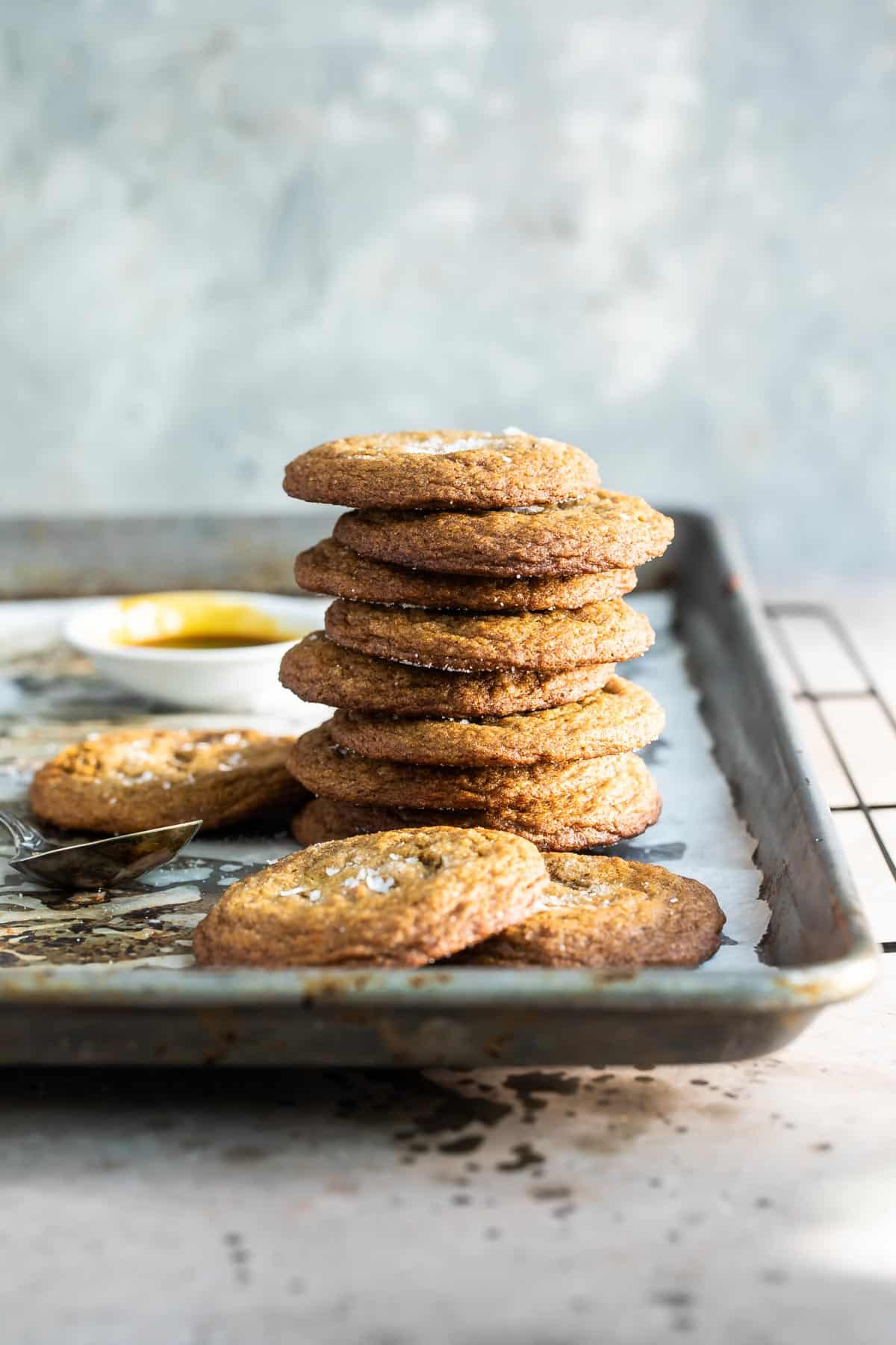 stack of molasses cookies on a baking pan