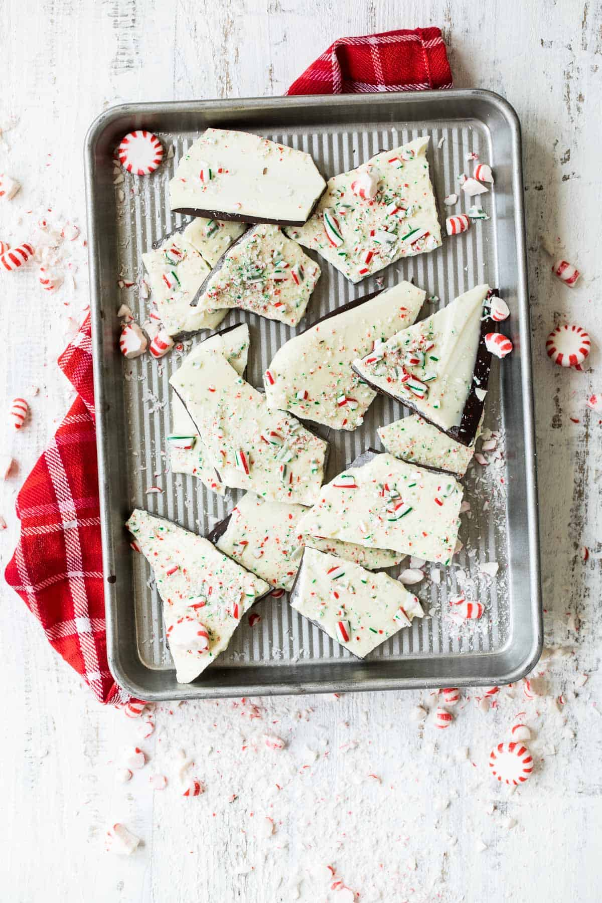 dark and white chocolate peppermint bark on a baking pan