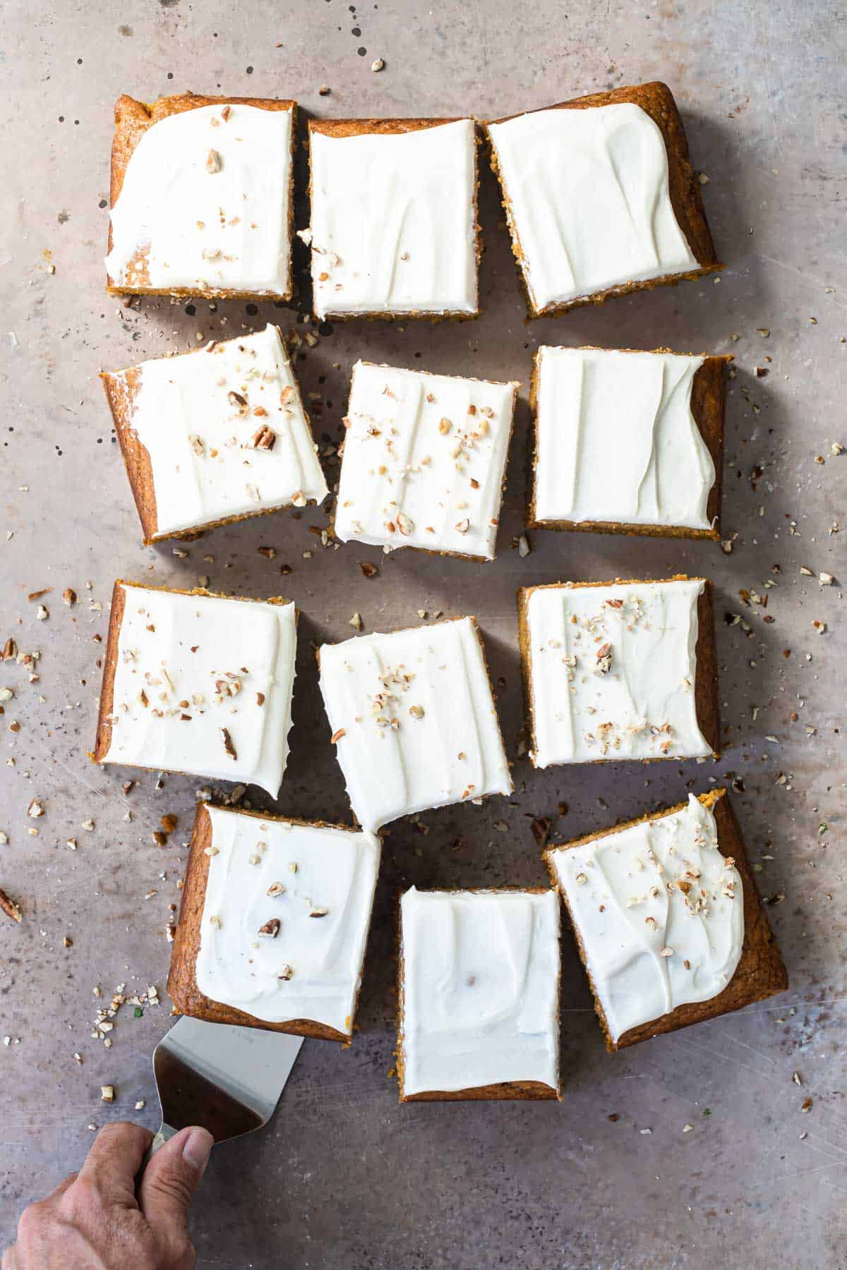 squares of pumpkin cake with cream cheese frosting
