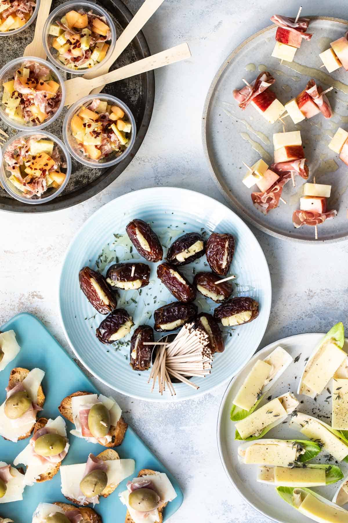 five easy appetizers on plates all made with cheddar cheese.