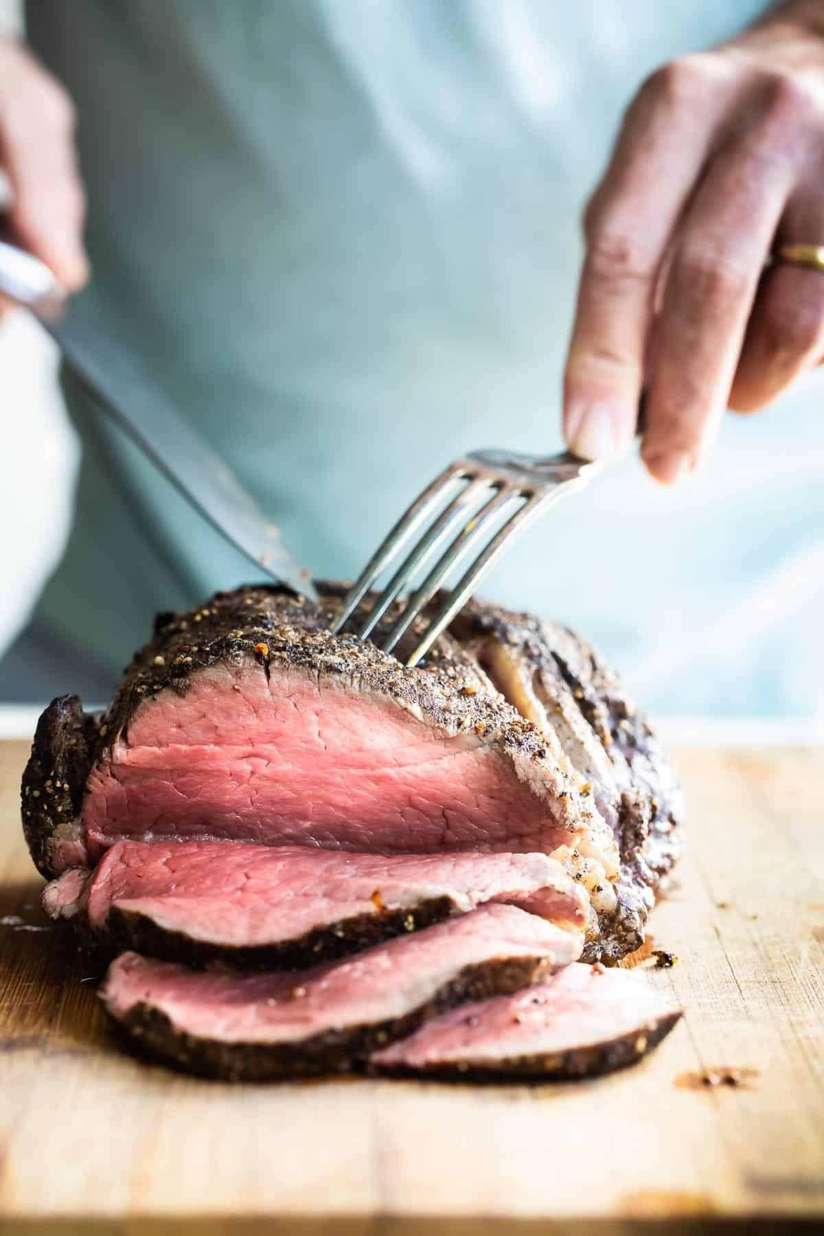 roast beef tenderloin being sliced