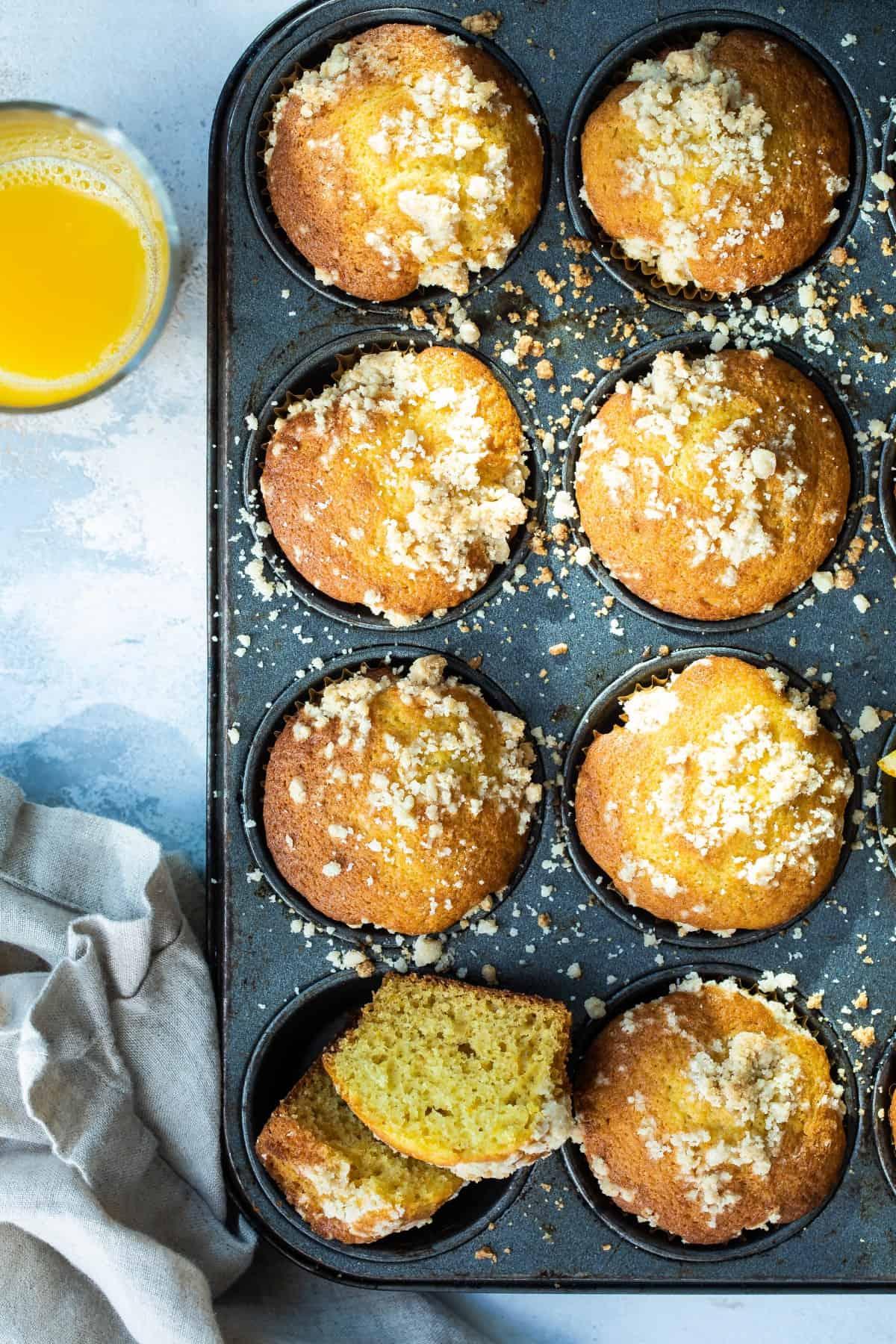 orange muffins in a baking pan