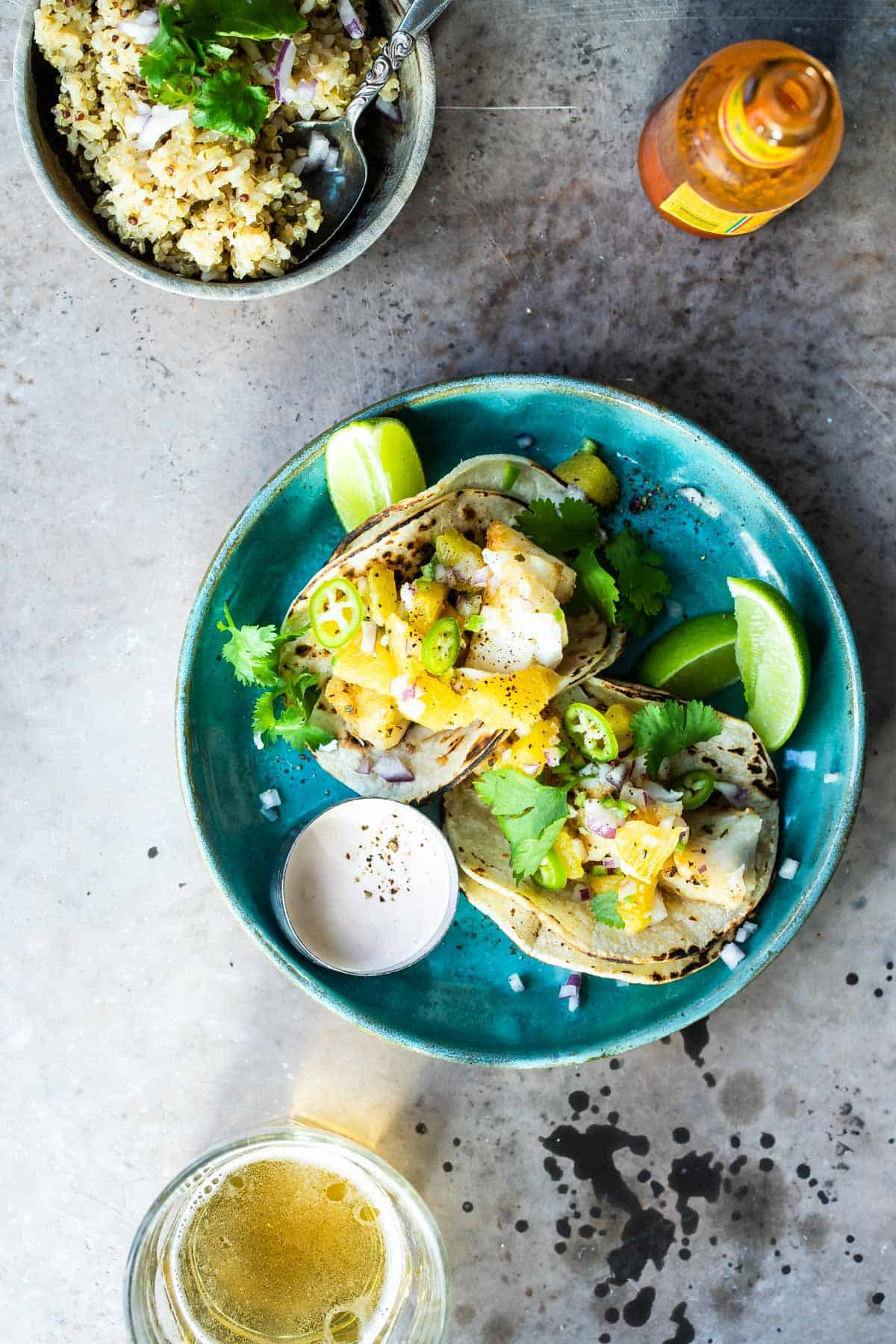 fish tacos on a plate with cilantro