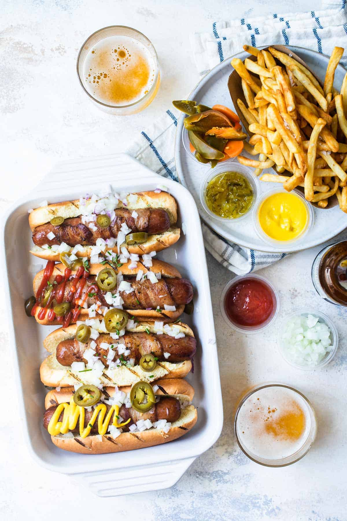 bacon wrapped hot dogs with toppings