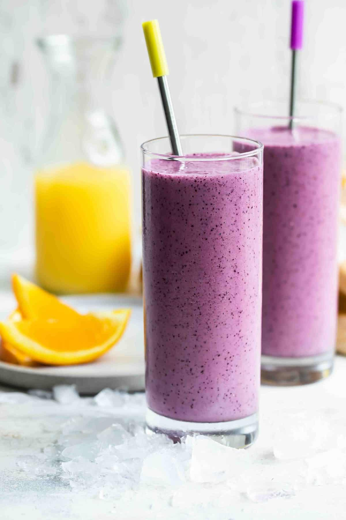 blueberry smoothie with orange juice in tall glasses