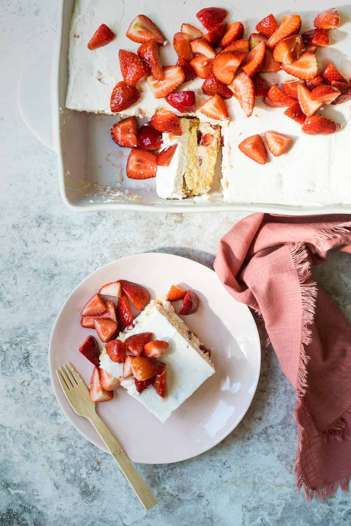 strawberry shortcake in a pan with fresh strawberries on top