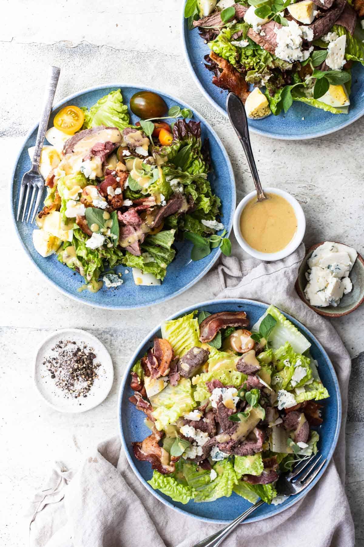 flank steak salad on plates