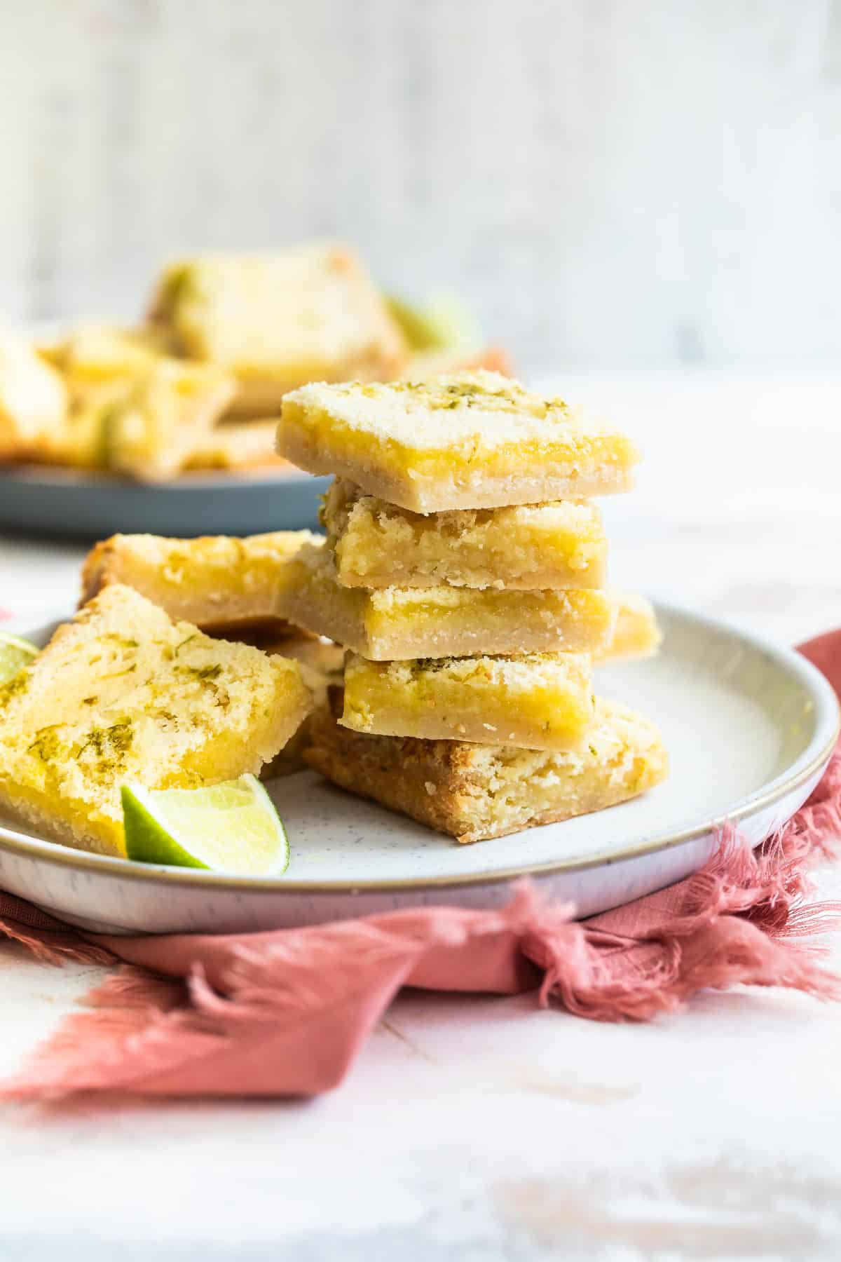 a stack of key lime bars on a plate