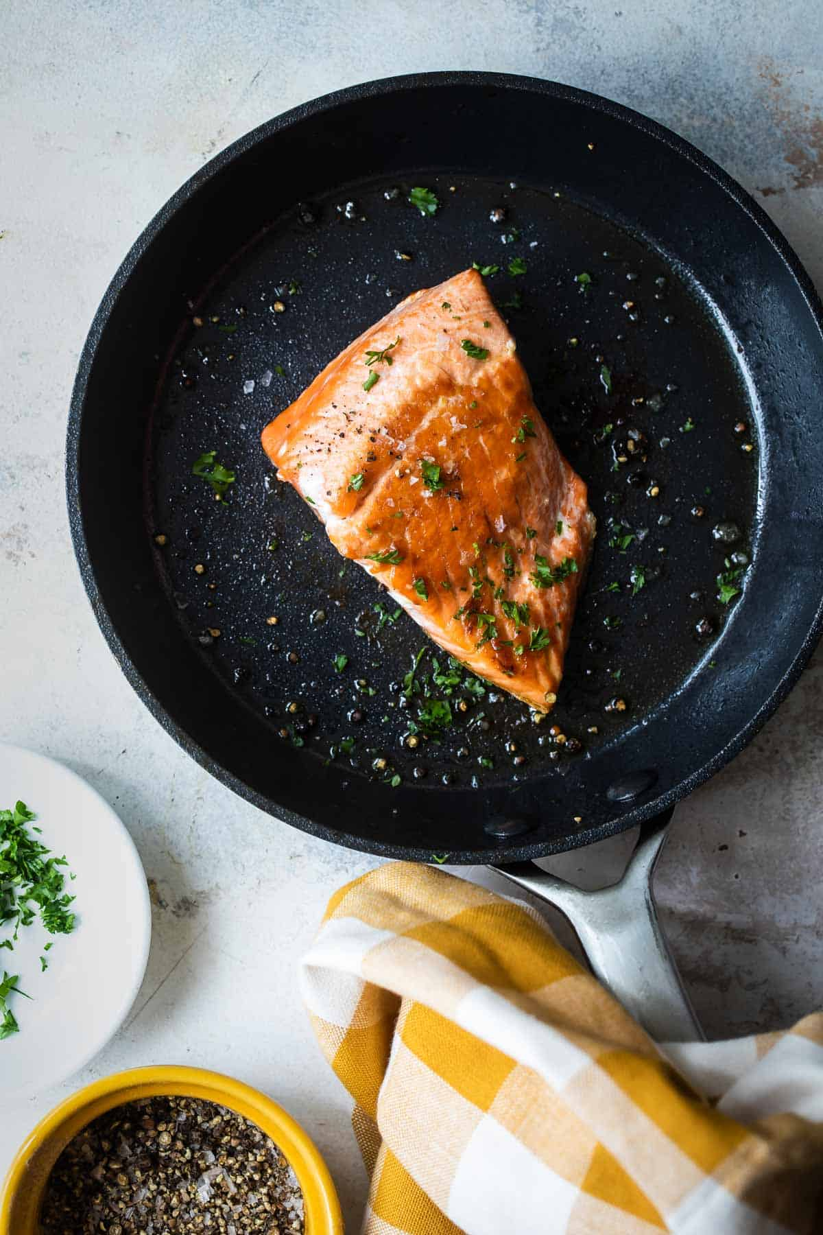 salmon in a pan after being cooked