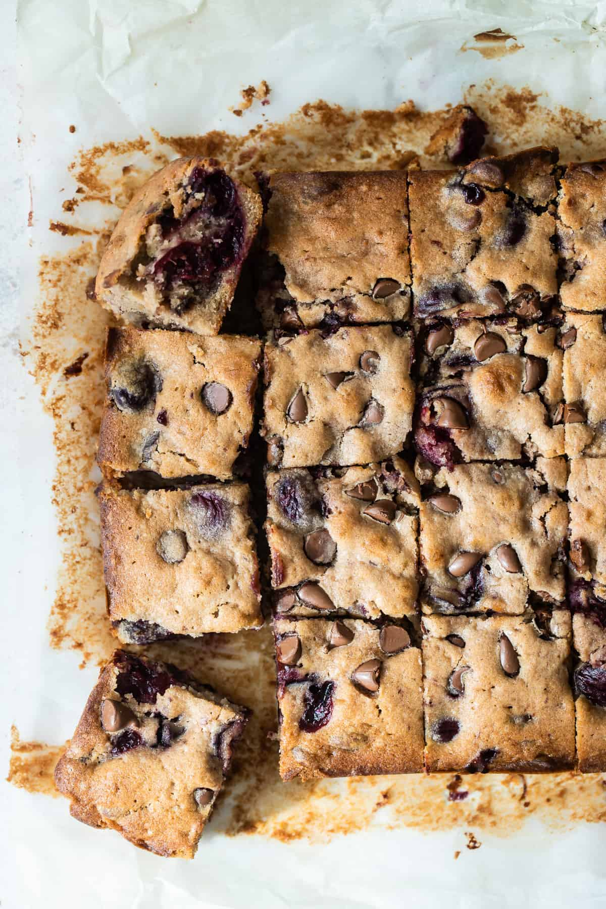 cherry bars cut into squares with chocolate chips